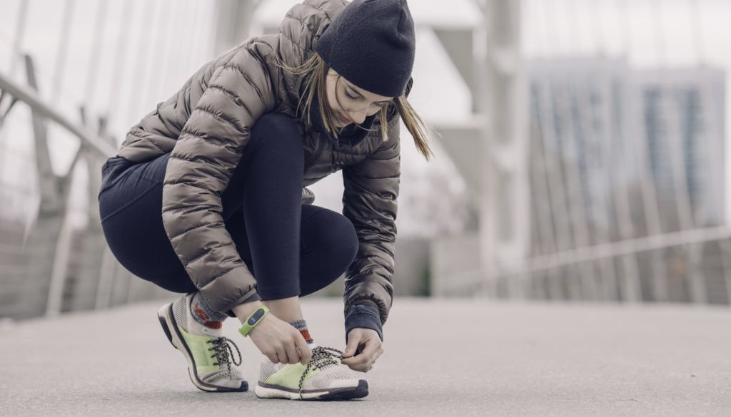 woman-athlete-tying-shoes